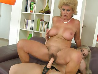 Mature hussy Effie can't keep her lips off Nesty's beaver