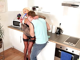 Blonde Sharon Pink with big jugs has fire in her eyes as she milks cum loaded rod of her man
