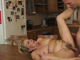 Mature with juicy tits gets her nice face painted with cock cream