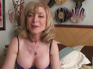 Blonde temptress Nina Hartley strips and plays with herself for your viewing enjoyment