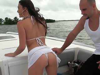 Brunette Victoria Love kills time fucking herself anally