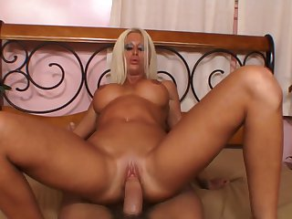 Blonde with massive tits has a good time playing with cum loaded cock