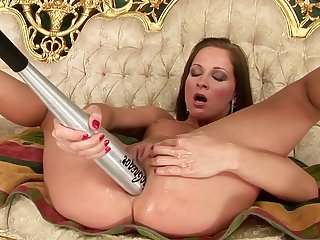 Brunette is horny as hell and fucks herself with her fingers with wild desire